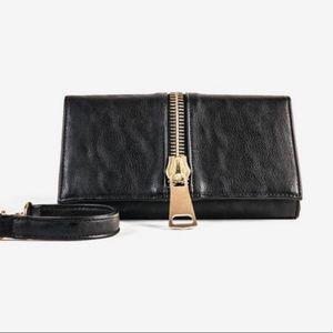 Zipper clutch or cross body bag. Like new. So cute